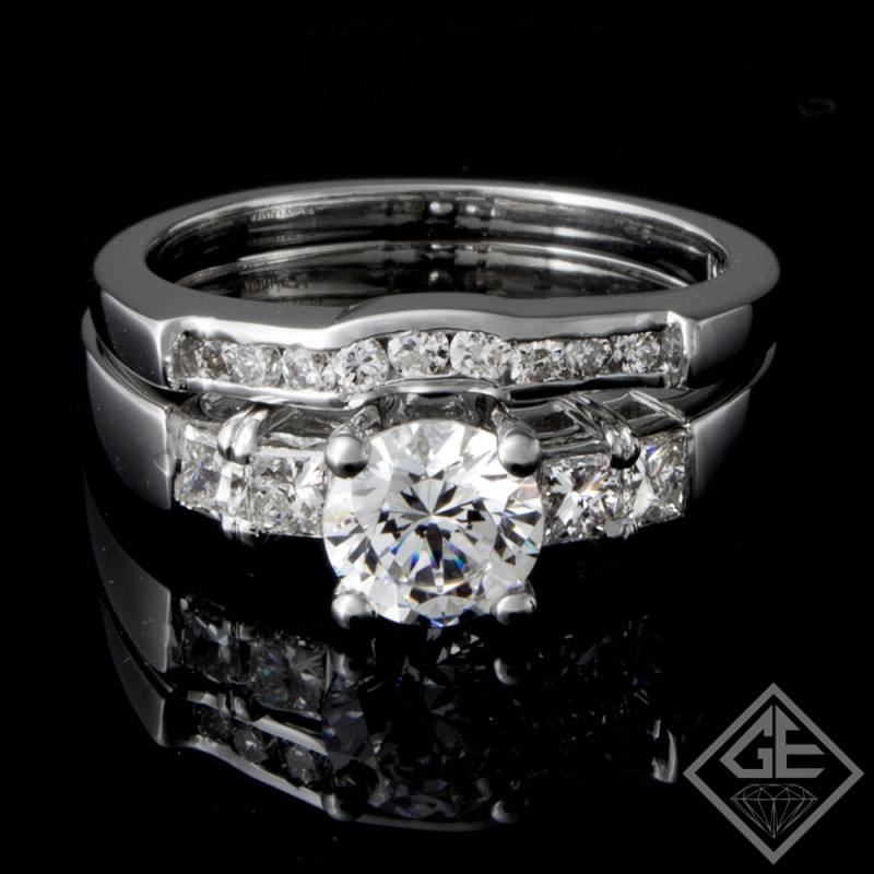 Ladies Diamond Bridal set Ring with 0.66 carat Round Brilliant and Princess cut side diamonds
