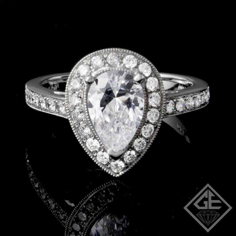 Ladies Pear Shape Halo Style Diamond Engagement Ring 18k Gold