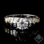Round Brilliant Cut and Baguette Diamond Engagement Ring in Platinum