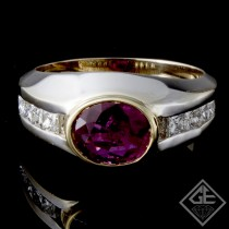 Ladies Antique Style Fashion Ring with 1.50 carats Oval Cut Ruby and 0.48 carats Princess Cut Diamonds in Channel setting 14k 2-tone Gold