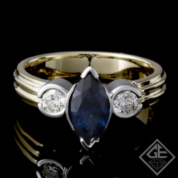 Ladies Beautiful 3-Stone Fashion Ring with 1.20 ct Blue Sapphire and 0.32 ct Round Brilliant Cut Diamonds in 14k 2-tone Gold